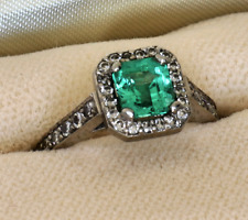 Platinum engagement ring, Colombian Emerald, pave