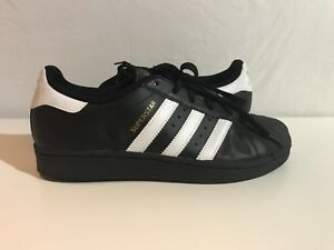 pre owned boys shoes size 6.5 adidas black. Minor wear.