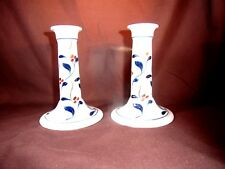 A pair of decortated pottery candlesticks