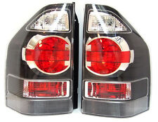 MITSUBISHI MONTERO PAJERO SHOGUN 2003-2006 rear tail lamps lights set BLACK