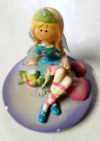 Statue girl from clay vintage decoration French figure looking into the sunset