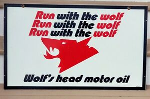 Wolf's Head Motor Oil Sign Original 1984 Run with the wolf. Double sided metal