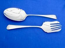 Serving spoon and fork.  Salad servers  Stainless steel.   Shiny