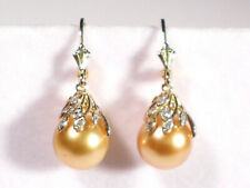 South Sea golden pearl dangle earrings,diamonds,solid 14k yellow gold.