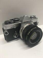 Olympus OM-2N camera Zuiko 50 mm f/1.8 lens batteries student photography class