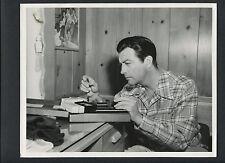 ROBERT TAYLOR EXAMINES SLIDE PHOTOS - 1947 DBLWT CANDID