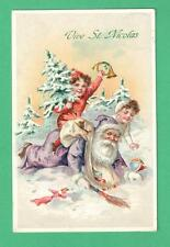 1910 CHRISTMAS POSTCARD KIDS PLAY/ ROMP ON SANTA CLAUS IN SNOW SACK TOYS TREE