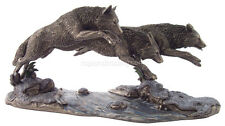 """Three Wolves on the Run Jumping Over a Stream (Bronze) 6.5"""" H X 14"""" L Statue"""