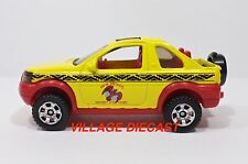 """2008 Matchbox """"Vacation"""" Land Rover Freelander YELLOW/NEW MEXICO ANCIENT/MINT"""