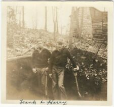 1910s Two Boys with Wooden Shovels Dig in Woods by Log House Snapshot