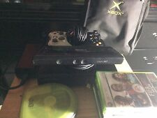 Black xBox 360 with 28 games, xbox connect, two controllers, bag, and cables