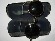 Ancienne paire de lunette façon écaille et verres teintés