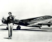 AMELIA EARHART PILOT STANDS IN FRONT OF LOCKHEED ELEKTRA - 8X10 PHOTO (EP-639)