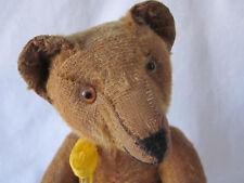 alter, antiker brauner Teddybär mit Buckel