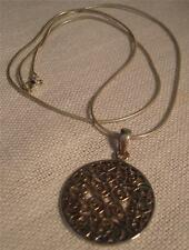 Snake necklace with a round pendant with a ornate feligree design marked .925