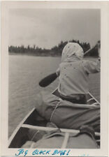 BIG BLACK BUGS! Back of woman rower with mystery dots, 1940s