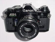 Canon AE-1 Program 35mm SLR Film Manual Camera + Canon 50mm F1.8 FD Lens - Black