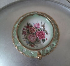 Vintage Japanese Lusterware Ring footed gilded quilted cup and open work saucer.