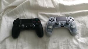 Lot of 2 PlayStation 4 Controllers *FOR PARTS NOT WORKING*