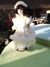 Collectible Doll in Fur and Pearl Coat on a Stand