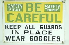 VINTAGE SAFETY FIRST SIGN BE CAREFUL EYE PROTECTION INDUSTRIAL FACTORY SIGN