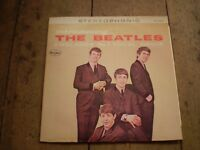 INTRODUCING THE BEATLES 1963 VINYL LP FIRST U.S.A  ALBUM FIRST ISSUE,NEAR MINT.