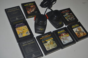 ATARI 2600 Paddle Controllers + 8 Stück PADDLE Spiele