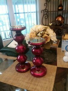 Candle holders Red1 is 16 inches tall 1is 12 inches tall