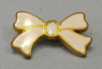 Vintage Bow Pin Gold Tone With Hard White Enamel