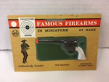 VINTAGE FAMOUS FIREARMS IN MINIATURE BY MARX TOY SIX SHOOTER CAP GUN NEW SEALED!