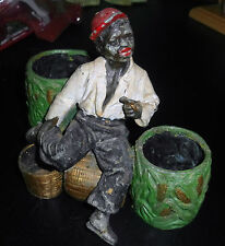 VINTAGE ◇ COLD PAINTED LEAD MATCH HOLDER MAN WITH PIPE SITTING ON CORN BASKET