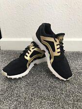 Adidas Racer lite Black Gold Used Junior / Ladies Size 5