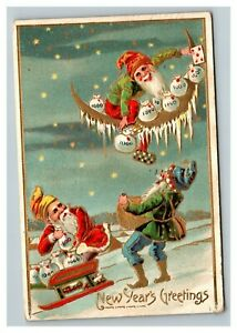 Vintage 1908 New Years Postcard Elves in Sled Take Ornaments off a Xmas Tree