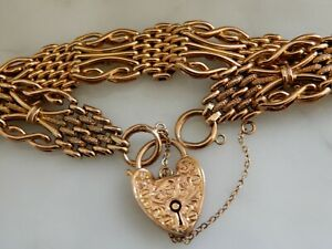 AN EXCEPTIONAL 9 CT ROSE GOLD ANTIQUE NIGHT AND DAY  HEART PADLOCK BRACELET
