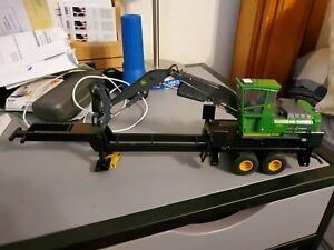 John Deere 3156G heel log loader trailer mount for pullingon truck kind of build