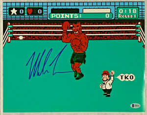 Mike Tyson Autographed 11x14 Punch Out Boxing Photo Signed Beckett BAS COA