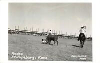 Phillipsburg Kansas~Crowd Along Fence Watches Rodeo Cattle Rustling~RPPC c1950