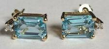 14k Yellow Gold Emerald Cut Blue Topaz 7 x 5mm Diamond Top Stud Earrings 1.6gram