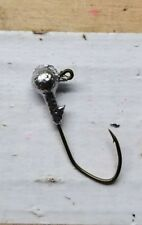 100ct. 1/8oz Unpainted jig head with #1 bronze Eagle Claw Lil' Nasty hook