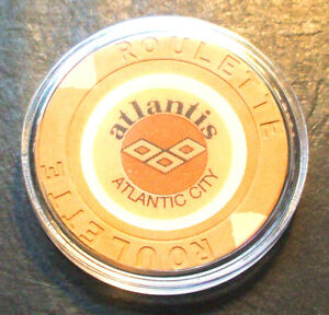 (1) Atlantis CASINO ROULETTE CHIP - 1984 - ATLANTIC CITY, New Jersey - Tan - K
