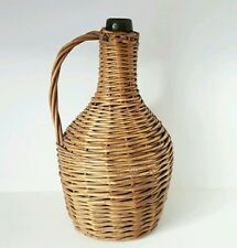 Vintage Rustic glass bottle in wicker basket with handle Demijohn Carboy