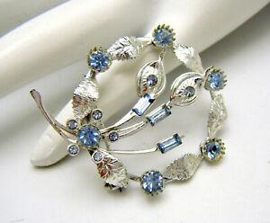 Vintage Light Blue Rhinestone Flowers Brooch Bright Silver Tone Foliate