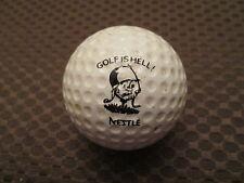 LOGO GOLF BALL-GOLF IS HELL! NESTLE FOODS........VINTAGE SPALDING