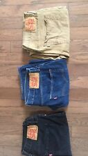 Levis Jeans Two 501 button fly (blue & black, One 541 zipper fly (tan).