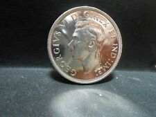 1947 Maple Leaf Canadian silver dollar, a great looking coin