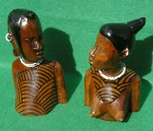 PAIR OF NATIVE MALE AND FEMALE BUSTS IN CARVED MID BROWN HARDWOOD STAIN DETAIL
