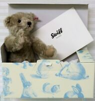 "The Steiff Club Annual Edition 2011, a gray colored mohair bear, is 12"" tall"
