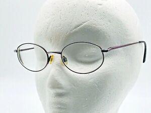 Anne Klein womens RX eyeglasses frames round wire pink metallic K1206 rose