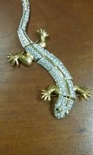 vintage lizard pin, 7 inches long. Rhinestone covered with green eyes.
