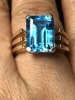 14k yellow gold Large Blue Topaz Emerald Cut ring 6.3 Grams Size 8.25